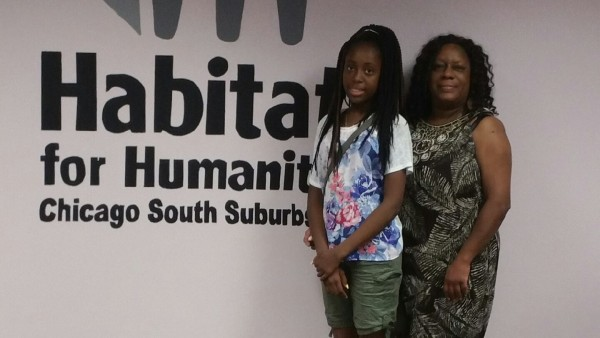 Habitat for Humanity Chicago South Suburbs welcomes it's newest future homeowner Mary A. Berry (right) and her daughter Mary K. Berry (left).